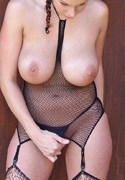 Gianna Michaels exposing her large tits from Busty Cafe